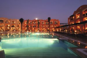 View of the hotel and pool at evening